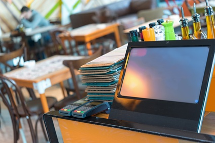 Point of sale, POS , table credit card terminal in modern restaurant
